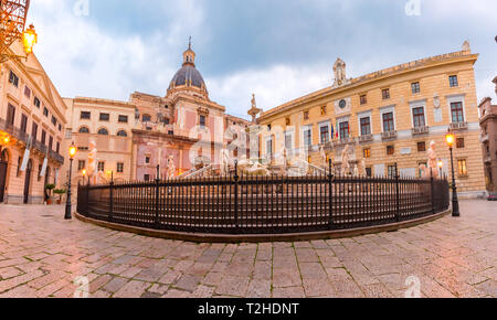 The Praetorian Fountain with church of Santa Caterina in the background on Piazza Pretoria, also known as square of Shame, Palermo in the morning, Sic - Stock Image
