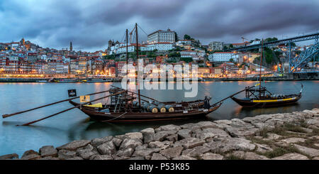 traditional Rabelo boats, Douro river, cityscape, panorama, twilight,  Porto, Portugal - Stock Image