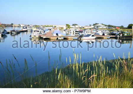 Littlehampton, UK. Sunday 8th July 2018. Boats moored at Littlehampton Marina on a very warm evening, near the South Coast. Credit: Geoff Smith / Alamy Live News. - Stock Image