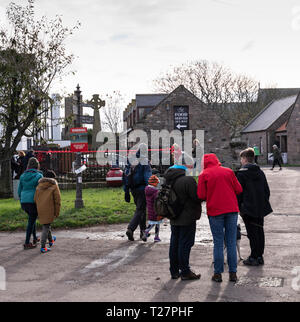 Lindisfarne or Holy Island, Northumberland coast south of Berwick-on-Tweed, England. Visitors in late October. - Stock Image