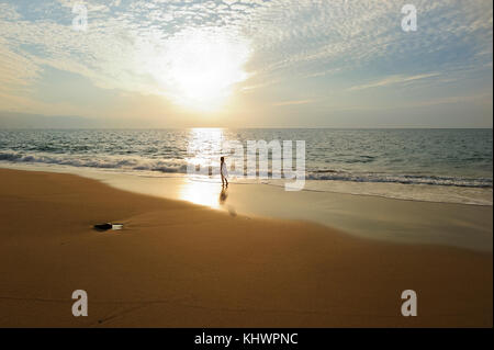 Spiritual soul girl ocean sunset beach is a girl on beach is a small girl soul looking in the the light of freedom - Stock Image