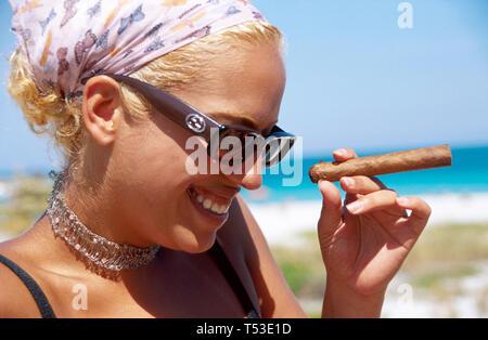 Miami Beach Florida fashionable Dominican cigar sunglasses bleached blonde hair - Stock Image