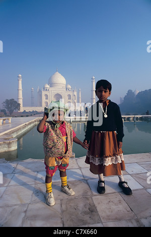 Two young children visitors at the Taj Mahal India - Stock Image