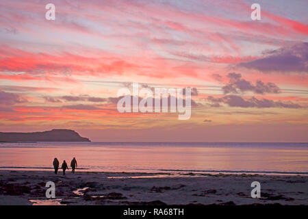 Calgary Bay, Isle of Mull, Scotland, UK. 1st January, 2019. People enjoying the sunset on the First Day of 2019 on Mull in the Inner Hebrides of Scotland Credit: PictureScotland/Alamy Live News - Stock Image