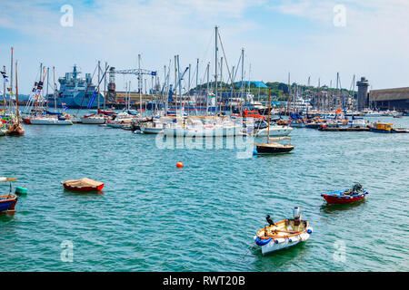 12 June 2018: Falmouth, Cornwall, UK - The harbour, with its mix of naval and civilian boats and ships. - Stock Image