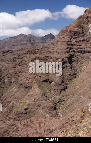 Winding road and mountain near Mogan, Gran Canaria, Canary Islands - Stock Image