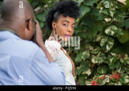Picture of photo shoot with a beautiful woman looking at the camera. - Stock Image