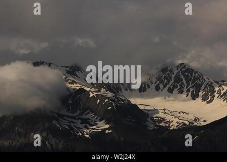 Aroser Rothorn seen from Obermutten, Switzerland. Cloudy summer day. - Stock Image