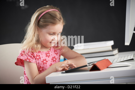 Young girl using iPad - Stock Image
