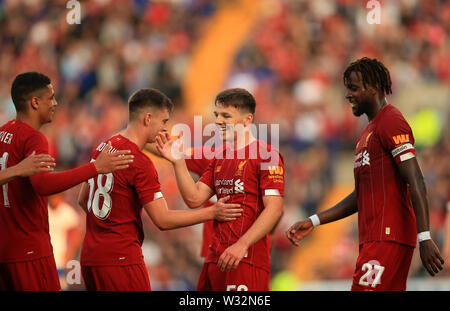 Prenton Park, Birkenhead, Wirral, UK. 11th July 2019. Pre-season friendly football, Tranmere versus Liverpool; Bobby Duncan of Liverpool is congratulated by his team mates after scoring his side's sixth goal after 67 minutes Credit: Action Plus Sports Images/Alamy Live News - Stock Image