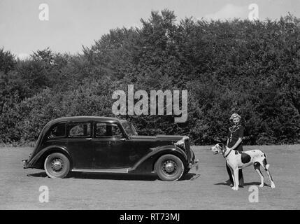 1938 Daimler DB18 . Lady with pet dog - Stock Image