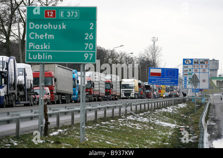 A line of loaded trucks waiting for customs clearance at Dorohust on the border of the Schengen zone between Poland - Stock Image