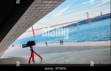 Lisbon, Portugal - Feb 25, 2019: Illustrative editorial of Panasonic mirrorless on a gorillapod at the MAAT Museum in Lisbon near river Tagus - Stock Image