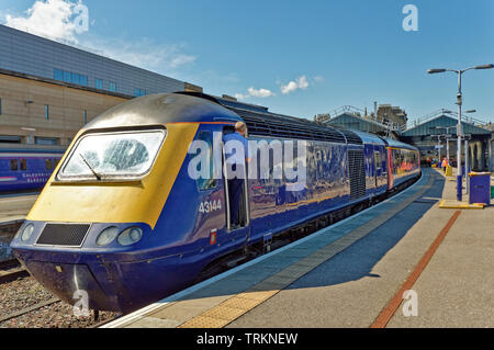 INVERNESS CITY SCOTLAND CENTRAL CITY SCOTRAIL RAILWAY STATION AND TRAIN PREPARING TO LEAVE AT PLATFORM THREE - Stock Image