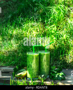 Green smoothie with parsley. On the summer background. - Stock Image