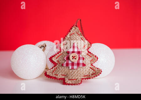 Christmas balls on red background - Stock Image