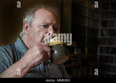 Senior man having a cup of coffee - Stock Image