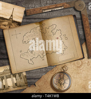 Travel still life. Old diary with treasure map. - Stock Image