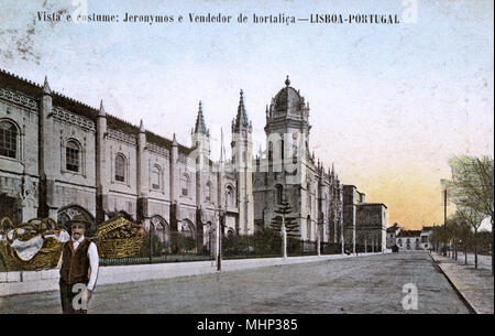 Jeronimos Monastery, Lisbon, Portugal, with a vegetable seller standing on the left.      Date: circa 1910 - Stock Image