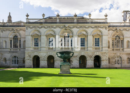 Exterior front courtyard of Kings College university Chapel with statue on well kept lawn, Cambridge, UK - Stock Image