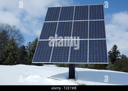 Pole mounted residential solar panel array, rated at 2.6 KW with 12 photovoltaic solar panels. - Stock Image