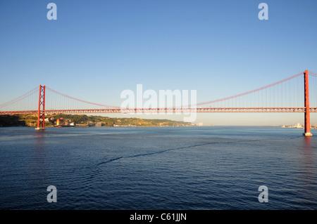 25 de Abril Bridge crossing over River Tagus, Lisbon, Portugal - Stock Image