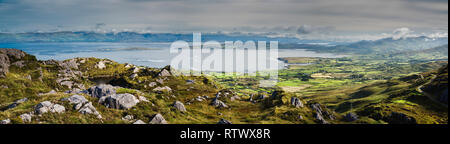 Panorama looking over Coulagh Bay from mountain top above Allihies, Beara Peninsula, West Cork, Ireland - Stock Image
