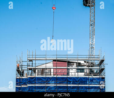 Gosford, New South Wales, Australia - August 3. 2018: Construction site and building progress update 113.  Rigging scaffolding on new home units build - Stock Image