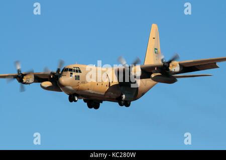 Military air transport. Royal Saudi Air Force Lockheed C-130H Hercules turboprop cargo plane on approach - Stock Image