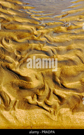 Sand patterns on a North Norfolk beach resulting from tidal action at East Runton, Norfolk, England, United Kingdom, Europe. - Stock Image