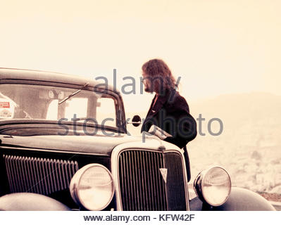 San Francisco rock n'roll poster artist, Stanley Miller, AKA Stanley Mouse, with his 1934 Ford in April, 1968. - Stock Image