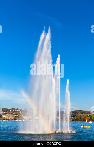 Beautiful view of the fountain at  Mythenquai with rainbow in the Zurich lake at sunset, Switzerland - Stock Image