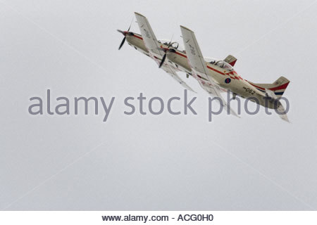 Croatian Air Force Pilatus PC-9 trainer aircraft flying in very close formation - Stock Image