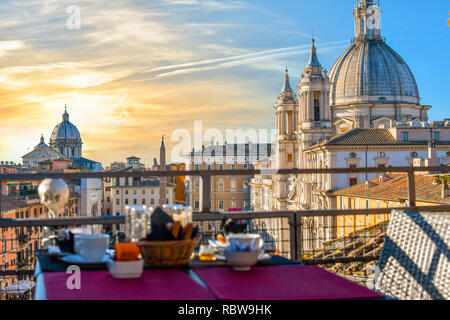 Continental breakfast on a roof top bar overlooking the Piazza Navona on an early summer morning. - Stock Image