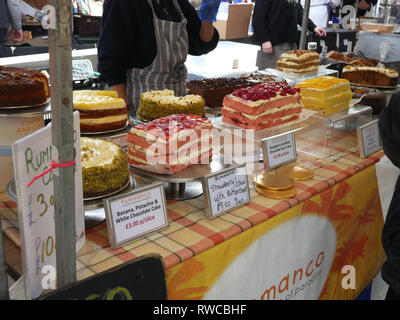 Assorted Cakes for sale on a market stall - Stock Image