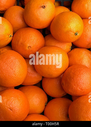 Spanish oranges for sale on a market in Tenby, Wales. - Stock Image