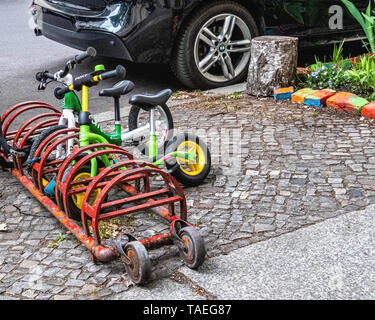 Tiny bike stand for childrens Bicycles. Little stand for Bicycle of Child - Stock Image