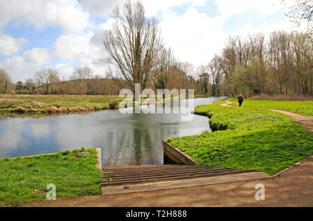 A small boat launching ramp into canal bypassing Horstead Mill from the River Bure at Coltishall, Norfolk, England, United Kingdom, Europe. - Stock Image