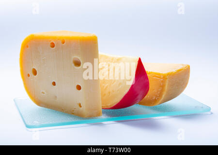 Assortment of traditional Dutch hard old cheeses made from cow milk  close up isolated - Stock Image