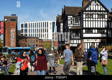 Pedestrians on Trinity Street in Coventry city centre UK - Stock Image