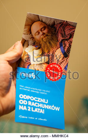 Poznan, Poland - March 23, 2018: Inea internet company leaflet being hold by a hand - Stock Image
