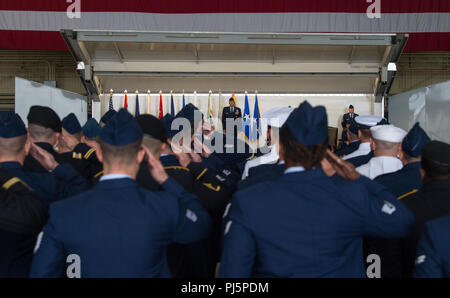 Joint service members render their first salutes to U.S. Air Force Lt. Gen. Tom Bussiere during a change of command ceremony for Alaskan North American Aerospace Defense Command, Alaskan Command, and the Eleventh Air Force at Joint Base Elmendorf-Richardson, Alaska, Aug. 24, 2018. Bussiere replaced U.S. Air Force Lt. Gen. Ken Wilsbach as commander. Family, friends, Arctic warriors and civic leaders from the surrounding communities attended the ceremony that was jointly-officiated by U.S. Air Force Gen. Terrence J. O'Shaughnessy, commander of the United States Northern Command and North America - Stock Image