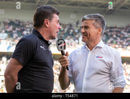 sports, football, Bundesliga, 2018/2019, Borussia Moenchengladbach vs RB Leipzig 1-2, Stadium Borussia Park, head coach Dieter Hecking (MG) left interviewed by Sky reporter Ecki Heuser, DFL REGULATIONS PROHIBIT ANY USE OF PHOTOGRAPHS AS IMAGE SEQUENCES AND/OR QUASI-VIDEO - Stock Image