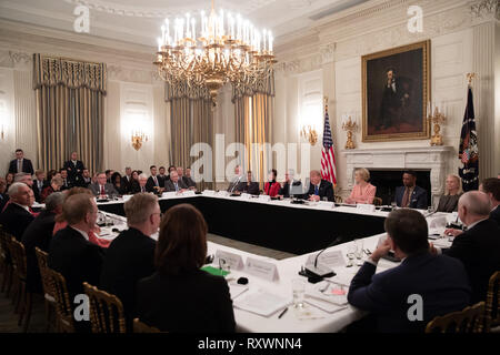 U.S President Donald Trump chairs the American Workforce Policy Advisory Board Meeting in the State Dining Room of the White House March 6, 2019 in Washington, DC. Attendees included Apple CEO Tim Cook, presidential daughter Ivanka Trump and Vice President Mike Pence. - Stock Image