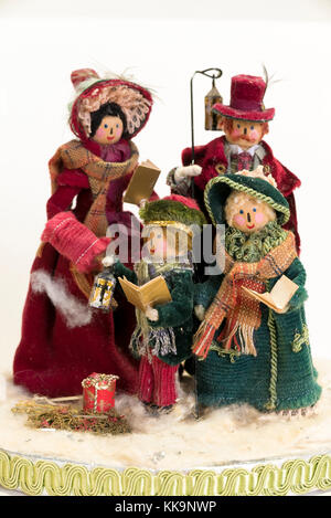 A Christmas festive decoration crafted from wooden pegs and assorted coloured fabrics, representing a family of - Stock Image