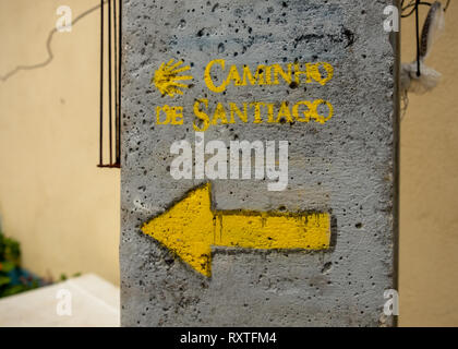 Arrow indicating the Caminho de Santiago (way of St James) in Portugal on a concrete pillar - Stock Image