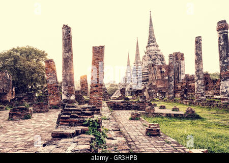 Vintage style ruins and pagoda ancient architecture of Wat Phra Si Sanphet old temple famous attractions during - Stock Image
