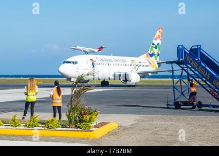 Cayman Airways passenger airliner arrives Juan Manual Galvez Airport Roatan Honduras. - Stock Image