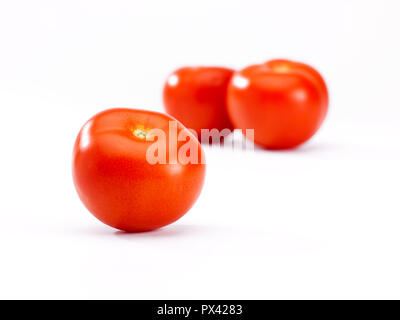 tomatoes in close up on a white background - Stock Image