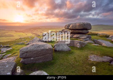 Sunset on Roo's Tor Dartmoor National Park Devon uk - Stock Image
